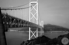 Shimanami Kaido | Japan bridges. The Shimanami Kaido route starts in Imabari and connects the main part of Shikoku with the 'mainland' of Japan. It's approx 75km long and contains of 7 bridges. A popular way of crossing the bridges is via bicycle.  This is the 6th crossing - the Innoshima Bridge. This one is different to the others as you cross over by walking on a pathway inside the bridge with the heavy traffic thundering back and forth above your head.