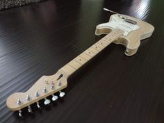 http://www.tdpri.com/forum/attachments/stratocaster-discussion-forum/124817d1335153642-strat-body-without-forearm-tummy-cut-contours-custom-strat-top-front-view-jpg
