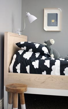 neutral kids room with cloud bedding