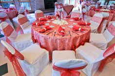 Wedding Decor- Coral Swirl Overlay Linen, White Chair Covers with Coral Swirl Bows and Hanging Candle Centerpiece surrounded by White Rose Petals