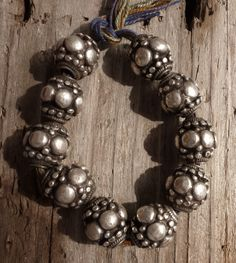 Antique large solid silver beads from Orissa, India.  Very scarce and not being made anymore because they are too labor intensive. Beautiful worn patina on these heirloom beads. ~ from Balthazara on Ebay