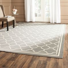 Add to the decor of your home both inside or out with these polypropylene indoor and outdoor area rugs. The dark gray rugs are weatherproof, resisting the fading effects of sunlight as well as damaging mold and mildew to provide you with years of use.