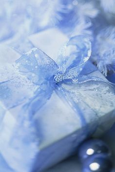 Gift box wrapped in white paper, via Flickr.