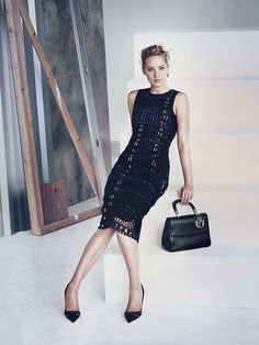Jennifer Lawrence in Dior's newest campaign wearing a black open-knit dress with black pumps