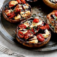 Garlic buttered Portobello Mushrooms stuffed and grilled with fresh mozzarella cheese, tomato slices and fresh shredded basil leaves, then drizzled with a rich balsamic glaze for the classic Caprese flavour!