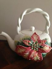 poinsettia teapot .. with large applied Christmas flower on side of white teapot, twisted bail handle, ceramic