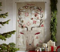 """Painted Reindeer Face Advent Calendar 36"""" wide x 63"""" high Expertly sewn of a linen/cotton blend. Features silk-screened and hand-painted art. Snowflakes and leaves are dated, showing clearly the approach of Christmas Day. Each date includes a cotton twill string to hang goodies."""