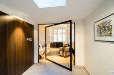 Black pivoting door with glass and unique 360° invisible hinges