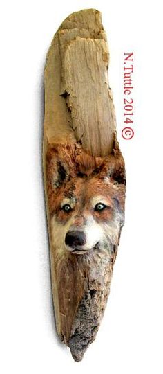"""""""Return to Nature"""" ''I carved this reverent creature into a piece of old growth Redwood found on a local beach here on the Oregon Coast. I told myself years ago I wouldn't carve anymore wolves but this wood was too perfect for it and I simply had a hankerin' to go for it! It' s carved into a single piece of wood. though most of what you see is the natural color of the redwood. Signed and dated: N. Tuttle 5/11/14"""