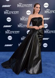 Angelina Jolie in a rubberized silk Versace gown at the Maleficent premiere