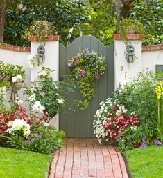 Garden Gate with a wreath. Nicely manicured lawn.
