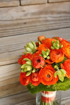 Redish Orange Ranunculus. Beautiful flowers! I plan to adorn my house with fresh flowers in the future.