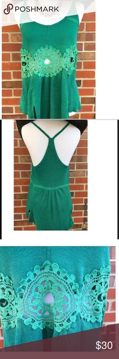 Flirty Free People NWOT fits like a Small Gorgeous flirty Free People tank with lacey panel and halter back. Festival fashion! Sz XS but fits a little big, more like a S. Never worn. Free People Tops
