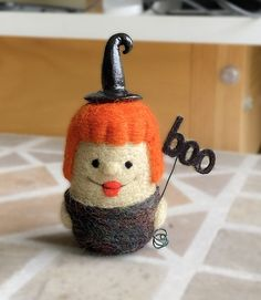 needle felted witch with felt boo sign
