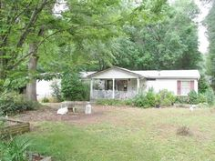 OFF MARKET$150,000-no show b4 10am or after 6pm.Modular Home on 14.33+/- wooded acres w/creek.Driveway shared but has approval from county to separate driveway to property.Split 3 bedrm2bath modular has living rm/dining rm combo,eat in kitchen&separate family rm.Front porch& covered back porch.Master bedrm w/2 walk-in closets,master bath w/separate tub/ shower.Sold as-is.Potential buyers will have to absorb cost for new survey to determine 14.33+/- acres.Please see docs in doc box.