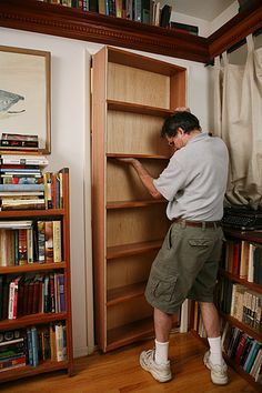 DIY closet book case as a hidden door. Great for a closet or a room that doesn't get used often