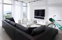 Fabulous minimal living room for a boutique hotel style residence (nice confined layout).