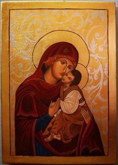 Ikona Matki Boskiej Pięknej Miłości . Złocona szlagmetalem, roślinny ornament wykonany ze srebra.