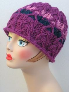 A modified cable stitch takes the stage in the Slipped Cable Hat. This pretty purple knit hat pattern features two contrasting stripes for an attractive accent. Knit with chunky yarn on large needles, this fitted hat is sure to keep your ears nice and warm.