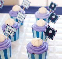 Baby Boy Cupcakes - Decorated and topped with frosting - Purple and Blue