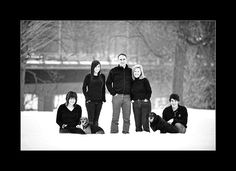 Family Winter Photo Shoot.  The black tops is an interesting idea.  Hmmm. What to think...
