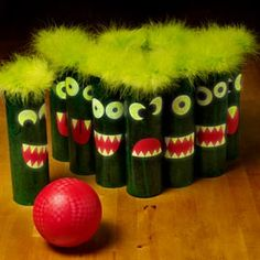 Make snack time craft time with this fun bowling set that uses chip cans, Mod Podge, and monster face cut-outs.