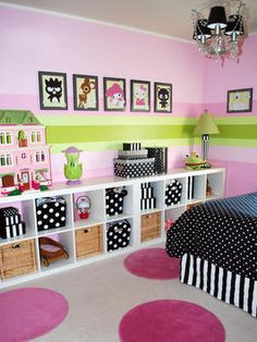 I know this is a Girls room, but I really like the set up, Stripes on the walls (in cool boy colors) Matching frames all lined up and the shelves, a good place to organize toys and still have style. Imagine this in Pixar decor