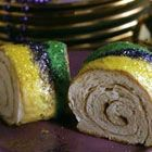 """By: Southern Living magazine   """"This highly recommended recipe originally appeared in Southern Living in January 1990. 12-years later, it is still a fitting end to any traditional Mardi Gras celebration."""" Bake a plastic baby inside.  Whoever find it has good luck!"""