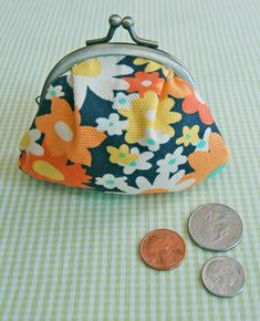 Coin Purse Tutorial at the Purl bee. Very simple with good directions. They have some just like these at Anthropologie, but these can be done with scrap fabric.