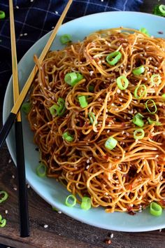A quick and easy Asian noodle side dish, Garlic Sesame Lo Mein is loaded with classic garlic and ginger flavour, as well as nutty toasted sesame seeds. Make it as spicy or as mild as you want with dried red chilies! Asian Noodle Recipes, Asian Recipes, Ethnic Recipes, Chinese Dry Noodle Recipe, Homemade Chinese Food, Zoodle Recipes, Veggie Recipes, Vegetarian Recipes, Tasty Noodles Recipe
