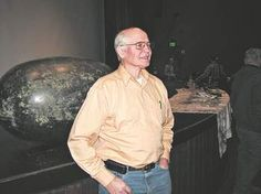 Oceanographer Jim Ingraham answers questions about the islands of debris from the March 11 Japan tsunami that are slowly floating toward the Pacific Northwest. Behind him is a float, found east of Neah Bay, that is believed to be the first identified piece of wreckage to arrive via ocean currents.