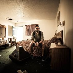 """A picture of myself during my """"the abandoned states of America""""  Tour trough Texas and New Mexico. Shot in the Sun & Sand Motel in Santa Rosa NM.  #sunandsandmotel #santarosa #newmexico #abadoned #motel #route66 #room #destroyed #old days #selfportrait #lostplaces #lostplace by emkyle_photography"""
