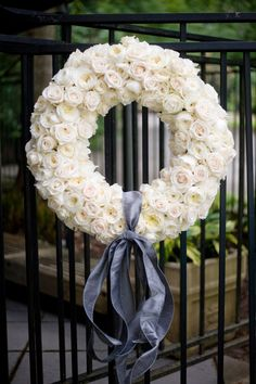 Your Event Solutions created this #weddingwreath of buttermilk Patience garden roses mixed with white hybrid tea roses for the Holt-Neumann wedding at the Birmingham Botanical Garden in Birmingham, Ala. The strong old rose and myrrh fragrances were sure to have pleased the wedding's guests.