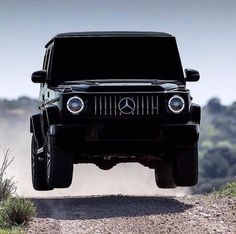 Airborne Mercedes G Wagon Would you go off-roading in this beast? Photo by Mercedes Suv, Mercedes G Wagon, Mercedes Benz G Class, Top Luxury Cars, Luxury Suv, Bmw E39, Jetta Mk5, Mercedez Benz, Triumph Bonneville