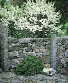 Stonework...cement posts with t bars between...