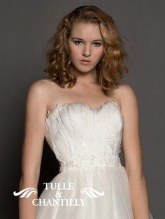 Feathers embellished bridal dress. It's fantastic!  www.tulleandchantilly.com