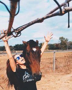"Jill T. having some fun in her ""Heels Down & Eyes Up"" jumper tee."