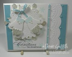 "Mitten Punch # 127824   Whisper White ccard stock # 100730   Baja Breeze card stock #111352  Baja Breeze 1/8"" Taffeta Ribbon 122964  Snow Flurry Bigz die # 127813  Floral Frames Framelits # 127012   Large Scallop Edgelits # 127019  Delicate Designs Embossing folder # 127023   Silver Glimmer paper # 124005  Basic Pearls # 119247    The greeting is from the stamp set called   More Merry Messages"