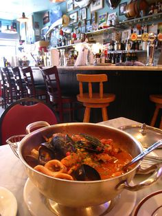 """San Francisco - Sotto Mare's cioppino truly is """"The best damn cioppino."""" The two of us could barely finish it. Sit at the counter and watch the cooks bust out dish after dish. We will always go back.  G."""