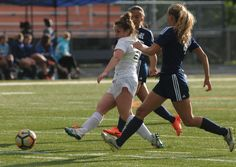 Ames' midfielder Anna Rood passes the ball between Des Moines Roosevelt defender Miranda Vermeer and forward Ivy Oconnor during the first half of the Little Cyclones' 5-0 victory on Tuesday at Ames High Stadium. Photo by Nirmalendu Majumdar/Ames Tribune http://www.amestrib.com/sports/20170523/girls-soccer-hartley-christensen-catches-fire-in-ames-5-0-win-over-roosevelt