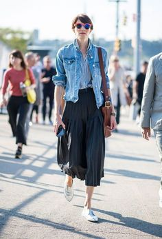 Stand out among other stylish civilians in a blue denim jacket and a black pleated midi skirt. Silver leather loafers will give your look an on-trend feel.   Shop this look on Lookastic: https://lookastic.com/women/looks/denim-jacket-dress-shirt-midi-skirt/21624   — White and Blue Vertical Striped Dress Shirt  — Blue Denim Jacket  — Brown Leather Crossbody Bag  — Black Pleated Midi Skirt  — Silver Leather Loafers  — Orange Sunglasses