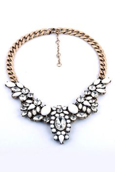 Chunky vintage gold necklace with crystal-inspired pendant accents. Pair with a sweater for your holiday party! #streetstyle
