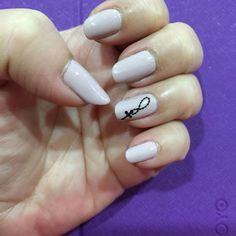 Nude nails with cross accent nailart