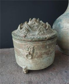 Lead glazed earthenware hill-jar, original bright green glaze reduced to silvery iridescence by degradation during burial. Late Eastern Han Dynasty