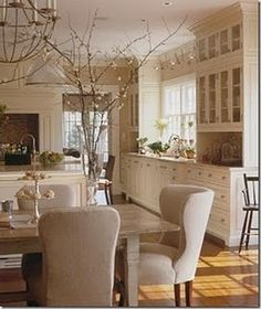 glass cabinets to the ceiling, love the off white color