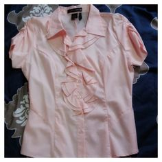 Pink Ruffle Button Down Blouse Short puff sleeve button down front with ruffle. Ruched sleeve and stretched fabric. NWOT mandee Tops Button Down Shirts