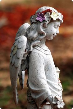 Beautiful angel with a floral wreath - @life_guide oracleofthespirit.com