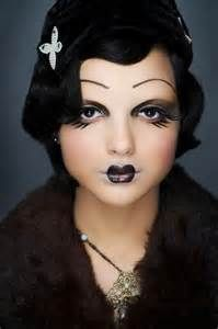 Vintage pierrot make-up. Small black painted lips and black eye make-up.