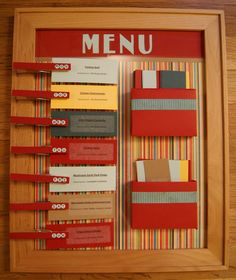 Menu Board -- I like the use of clothespins and that the meal cards are color-coded by type of meal (chicken, vegetarian, quick and easy, etc.)