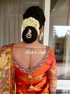 Perfect example of how a groom's mother can dress for the wedding. Makeup and hairstyle by Swank studio. Hairbun. Hair accessory. Fresh flowers. Saree blouse design. Silk saree. Find us https://www.facebook.com/SwankStudioBangalore